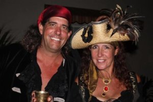 A man and a woman dressed in pirate garb.