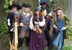 Man and women dressed in pirate garb holding musical instruments.