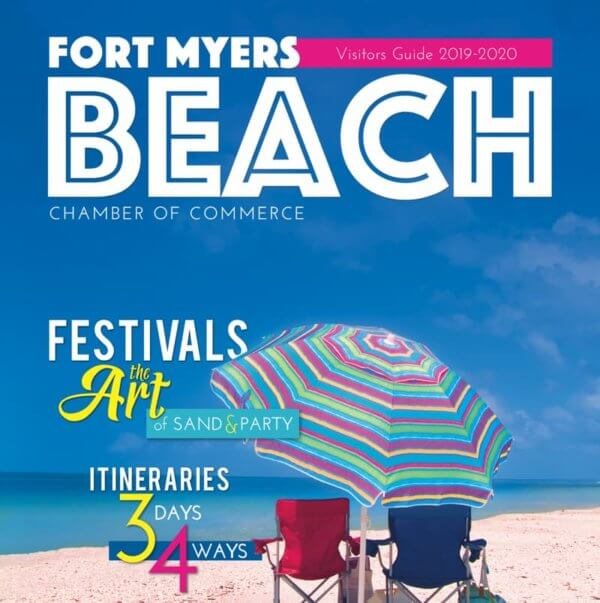 A magazine cover with an umbrella and chairs on the beach.