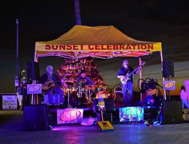 Image of the bank High Tide playing at night on the Times Square stage on Fort Myers Beach.