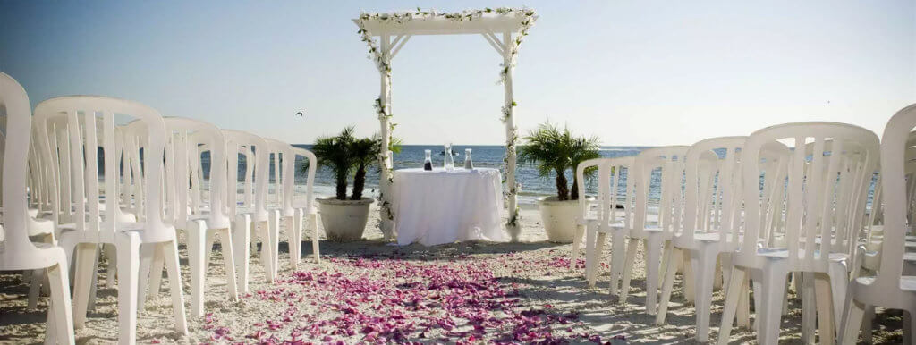 Chairs and an altar on the beach for a beach wedding.