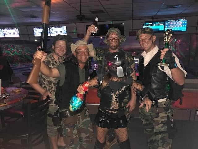 A group of people dressed up like characters from the movie Predator.