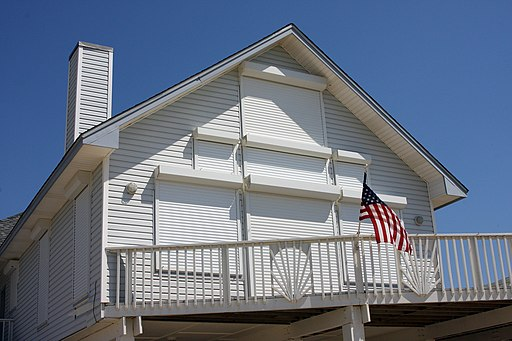 A house is tightly shuttered up in preparation for a hurricane.