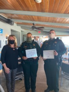 Two Lee County Sheriff Deputies receive their Deputy of the month award.