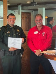 Deputy Derek Matera receives his Deputy of the Month award for May 2021