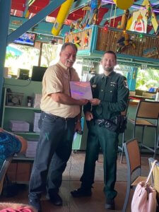 Kyle Hargis receives his Deputy of the Month award from the FMB Chamber.